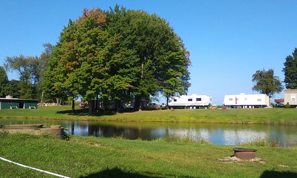 RV Campers by the Pond at Pine Lane Campground